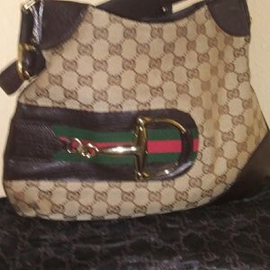 "Gucci Jackie Canvas w/ Metal "" Butter "" horseshoe"